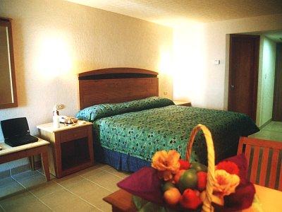 Casa mexicana cozumel hoteles en cozumel for Casa mexicana muebles